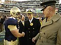 US Navy 061202-N-0696M-535 Chief of Naval Operations (CNO) Adm. Mike Mullen, and Commandant of the Marine Corps Gen. James T. Conway, exchange handshakes with Midshipmen offensive guard Ricky Moore (68).jpg