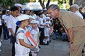 US Navy 070209-N-9860Y-331 Commander, U.S. 7th Fleet, Vice Adm. Doug Crowder thanks a student from Manila's Trichet Learning Center for her performance during a community service project.jpg
