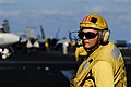 US Navy 070216-N-3729H-011 Aviation Boatswain's Mate Chief Richard Harmor monitors the safe movement of aircraft aboard the Nimitz-class aircraft carrier USS John C. Stennis (CVN 74).jpg
