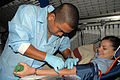 US Navy 070425-N-7312S-074 A ship's serviceman donates blood during a blood drive aboard amphibious command ship USS Blue Ridge (LCC 19).jpg