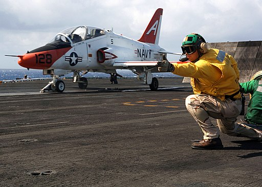 US Navy 070507-N-7090S-001 Lt. Cmdr. Matt Foster of Jacksonville, Fla., signals to the pilot of a T-45 Goshawk, attached to Training Air Wing (TW) 1, that he is ready to launch from nuclear-powered aircraft carrier USS Enterpri