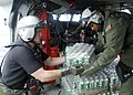 US Navy 070907-N-7540C-027 U.S. Navy air crewman assigned to the Dragon Whales of Helicopter Sea Combat Squadron (HSC) 28, distribute relief supplies.jpg