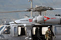US Navy 070907-N-8704K-026 Aviation Warfare Systems Operator 2nd ClassRussel Moldenhauer, attached to Military Sealift Command hospital ship USNS Comfort (T-AH 20), stands by an MH-60S Seahawk attached to Helicopter Sea Combat.jpg