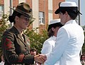 US Navy 080829-N-8848T-896 Marine Gunnery Sgt. Sandra Center, a drill instructor at Officer Candidate School, congratulates Ensign Elizabeth Swart, from Harbert, Mich.,.jpg