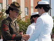 US Navy 080829-N-8848T-896 Marine Gunnery Sgt. Sandra Center, a drill instructor at Officer Candidate School, congratulates Ensign Elizabeth Swart, from Harbert, Mich.,