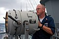 US Navy 080925-N-1706T-003 Information Systems Technician 1st Class Kevin Heitsman signals the guided-missile frigate USS Klakring (FFG 42) during a group navigation exercise.jpg