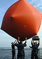 US Navy 081026-N-4557K-001 Sailors heave the.jpg