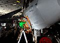 US Navy 081213-N-7571S-003 Aviation Structural Mechanic 1st Class Keum Bird masks the intake of an EA-6B Prowler.jpg