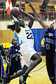 US Navy 090517-N-8726C-002 All-Navy basketball team member Electronic Technician 3rd Class Natassijija Mitchelle, from San Diego, drives to the basket for two points during the championship game.jpg
