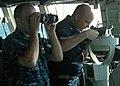 US Navy 091120-N-7058E-235 Fire Controlman 2nd Class Justin Silva tracks a simulated suspect vessel as Chief Fire Controlman Reo Logan relays the vessel's bearing.jpg