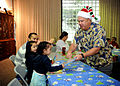 US Navy 091214-N-6326B-029 Master Chief Hospital Corpsman Jeff Apana hands out gifts to the children of staff from Naval Medical Center San Diego.jpg