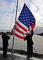 US Navy 100118-N-1082Z-009 Sailors lower the national ensign aboard the amphibious dock landing ship USS Ashland (LSD 48.jpg