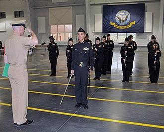 James Ford Rhodes High School - Image: US Navy 100313 N 8848T 481 Chief Fire Controlman Robert Church salutes Navy Junior ROTC Cadet Seaman Kenny Pena, 15, a sophomore and drill commander from James Ford Rhodes High School in Cleveland, Ohio