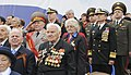 US Navy 100510-N-8288P-047 Vice Adm. Harry B. Harris Jr., commander of the U.S. 6th Fleet, stands at attention among Russian veterans during the opening ceremony at the 65th anniversary of Victory in Europe celebrations.jpg