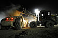 US Navy 100613-N-0475R-659 Equipment Operator 3rd Class Jeremy Ott, a Seabee assigned to Naval Mobile Construction Battalion (NMCB) 5, uses a loader to move fill at a project at Camp Leatherneck.jpg