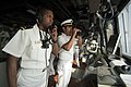 US Navy 100615-N-5319A-007 Ensign Damion Jones speaks to the forward observer on a sound-powered phone next to Mexican navy Lt. Navarrete on the bridge of the amphibious transport dock ship USS New Orleans (LPD 18).jpg