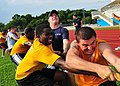 US Navy 100709-N-7643B-296 Sailors and Coast Guardsmen participate in a game of tug-of-war as part of the Cooperation Afloat Readiness and Training Singapore 2010 sports day.jpg