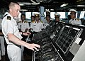 US Navy 100811-N-3215T-056 Lt. j.g. Brian Hamilton describes the functions of the helm aboard the guided-missile destroyer USS John S. McCain (DDG 56) to Vietnamese officers during a tour of the ship.jpg