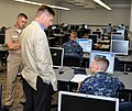 US Navy 100812-N-7682A-001 Seaman Ryan Brown explains his computer based training curriculum to the Juan M. Garcia III at the Center for Surface Combat Systems Unit technical training facility.jpg