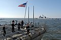 US Navy 101220-N-5292M-469 Sailors aboard the guided-missile destroyer USS Ross (DDG 71) tie the ship to the pier.jpg