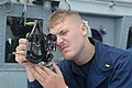 US Navy 111110-N-IO627-031 Ensign Nick Green measures distance with a telescopic adelaide aboard the forward-deployed guided-missile destroyer USS.jpg