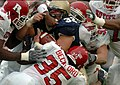 US Navy 2 Six Rutgers University defenders attempt to tackle U.S. Naval Academy Midshipman 1st Class Kyle Eckel.jpg