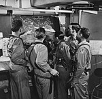 US Navy pilots study the target area prior to strikes on Hong Kong in January 1945.jpg