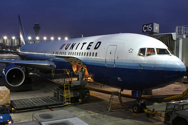 A United Airlines Boeing 767-300 gets loaded at Chicago O'Hare