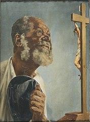 Negro com Chapéu na Mão Olhando Para um Crucifixo