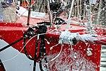 Vendée Globe 2012-2013 Tanguy de Lamotte Initiatives-cœur Essais pour le baptême du bateau (explosion de la bouteille).JPG