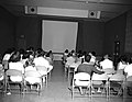 Visitors at orientation program at Visitor Center auditorium. ; ZION Museum and Archives Image ZION 8771 ; ZION 8771 (9d5a9ef544de4b3bb625b559b1eee45c).jpg