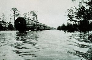1916 Gulf Coast hurricane - A train makes its way through floodwaters along the Tombigbee River near Wagar, Alabama.