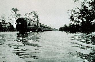 1916 Gulf Coast hurricane - A train makes its way through floodwaters along the Tombigbee River near Wagar, Alabama.