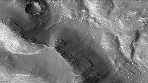 Lampland (Martian crater) - Layers in wall of Lampland Crater, as seen by CTX camera (on Mars Reconnaissance Orbiter). Note: this is an enlargement of the previous image of Lampland Crater.