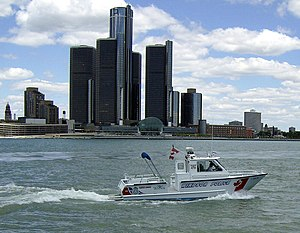 Detroit River - A Canadian police boat from Windsor, passing by the Renaissance Center in 2007.