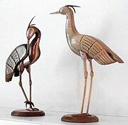 Woodcarvings of cranes