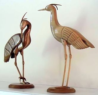 Artists can use woodworking to create delicate sculptures. Woodcarvings of cranes.jpg