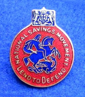 "National Savings Movement - A World War II badge showing St. George and the Dragon and the slogan ""Lend to Defend""."