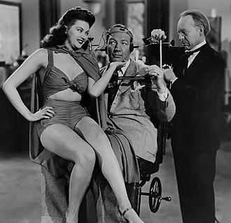 Yvonne De Carlo - De Carlo's first film role in Harvard, Here I Come! (1941), starring boxer Maxie Rosenbloom (center)