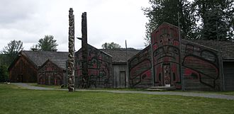 Totem pole - Totem poles and houses at 'Ksan, near Hazelton, British Columbia.