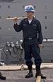 050519-N-9851B-003 - SN Walter Stewart holds a sledgehammer in preparation to release pelican hooks.jpg