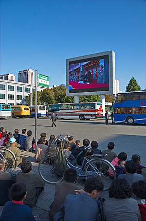 Public broadcasting - People in Pyongyang watch a public display of KCTV.