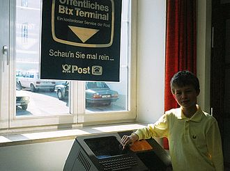 Bildschirmtext - 1987 Photo of a German Youth in standing next to a German Post Office Btx Terminal