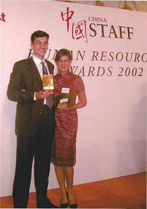 Nigel Cumberland - Cumberland with his wife and co-founder of St. George's Consulting, receiving the 2002 China Staff Magazine HR Award for their firm at Hong Kong's Ritz Carlton Hotel.