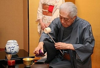 Japanese tea ceremony - The elaborate and refined Japanese tea ceremony is meant to demonstrate respect through grace and good etiquette as demonstrated here by Genshitsu Sen, 15th Grand Master of the Urasenke Tea School