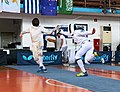 2nd Leonidas Pirgos Fencing Tournament. Flèche by Nikolaos Tsokas, 6th parry by Matthew Baker.jpg