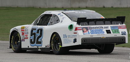 Rear of NASCAR driver Joey Gase's car paying homage to Wilson by urging people to be an organ donor. 52 Joey Gase tribute to Justin Wilson 2015 Road America.jpg