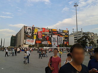 Atatürk Cultural Center - Posters, banners and flags on the AKM building, during the 2013 protests.