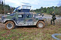 A Czech soldier with Engineer Company, 72nd Mechanized Battalion directs a Humvee.jpg