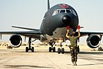 A KC-10A Extender aircraft is guided into a parking space on the flight line during the multinational joint service Exercise Bright Star '85 DF-ST-86-08017.jpg
